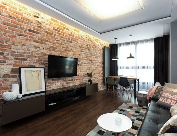 brick tv wall in an amazing modern living room