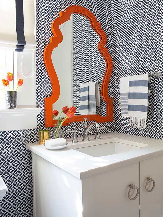 amazing bathroom with blue tiles and orange accent mirror luxazin