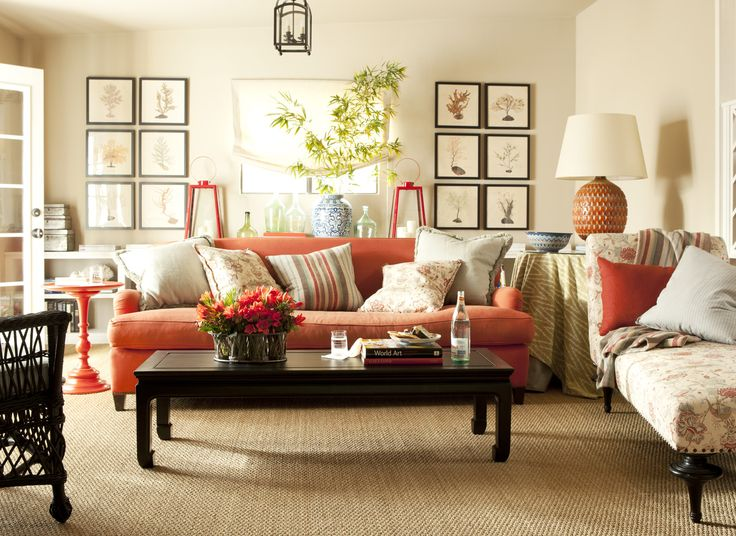 cozy living room using orange sofa with white wall luxazin