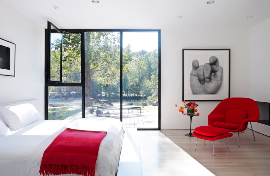 modern bedroom red chair black and white
