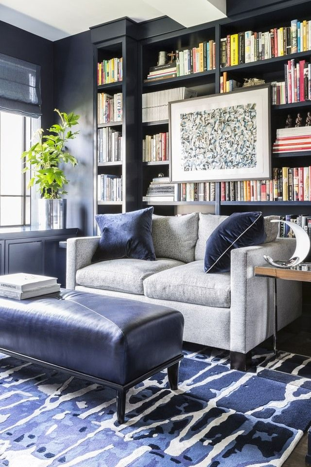 bold colors reading room with hanging art work luxazin